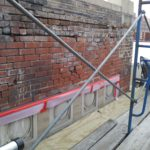 Extior parapet wall conditions prior to Brick repair, pointing, and Hard Stucco