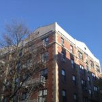 Finished Hard Coat Stucco installed by Anchor Stone and Stucco at Top of Residential Building in Hoboken, NJ