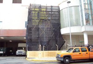During Exterior Facade Restoration using EIFS system with textered acrylic stucco