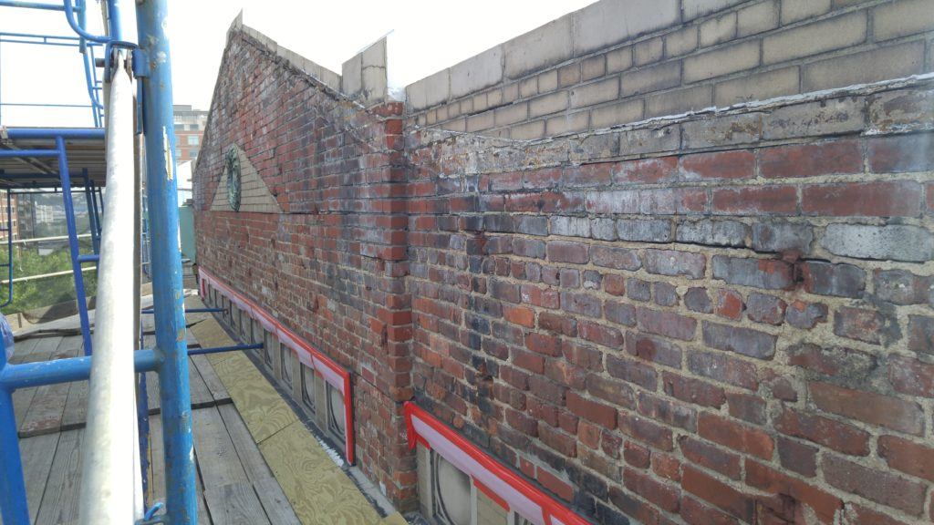 Before parapet and wall conditions prior to masonry repairs and new Hard Stucco