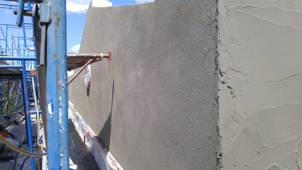 Installation of Stucco brown coat by plastering contractor in New Jersey